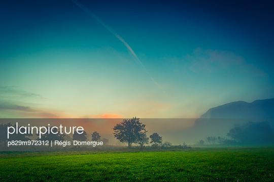 Sunrise near Pic Saint-Loup - p829m972312 by Régis Domergue