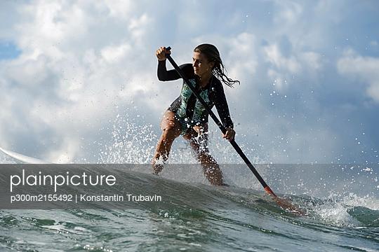 Female SUP surfer, Bali, Indonesia - p300m2155492 by Konstantin Trubavin