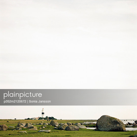 View of distant Lange Jan lighthouse on Oland, Sweden - p352m2120672 by Sonia Jansson