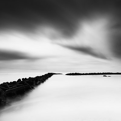 Long exposure of tetrapods in the sea and dramatic sky, Inamuragasaki - p1166m2078133 by Cavan Images