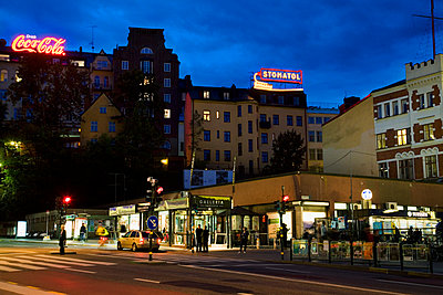 Sweden, Stockholm, Sodermalm, Slussen, City street at night - p352m1126647f by Lena Katarina Johansson