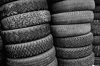 Stacks of car tyres   - p8476639 by Tuija Lindström