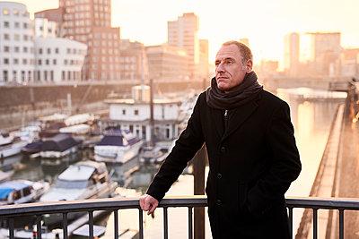 Man on bridge in Media harbour - p890m1217313 by Mielek