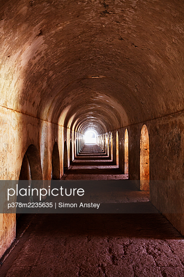 Arched passageway - p378m2235635 by Simon Anstey