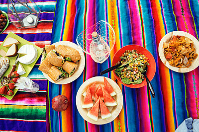 High angle view of food served on picnic blanket - p1166m1174264 by Cavan Images