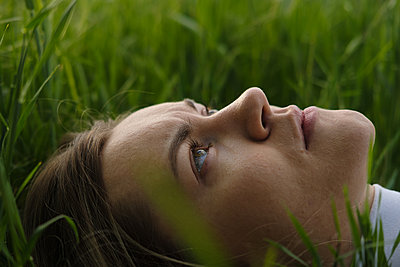 Woman lies in the grass - p1363m2122478 by Valery Skurydin