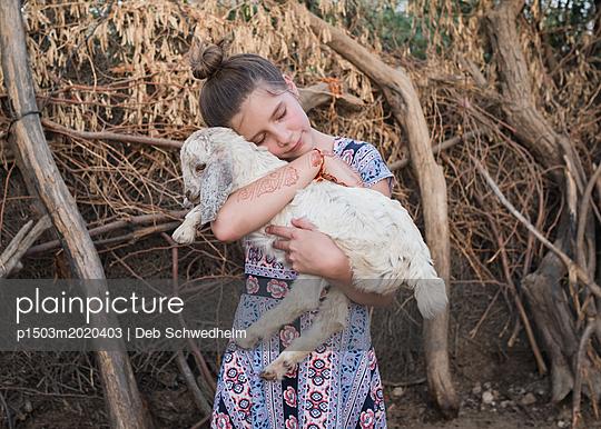 Girl Hugging Sheep - p1503m2020403 by Deb Schwedhelm