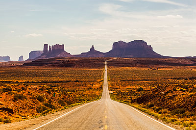 A road leading to rugged rock formations in the desert; Arizona, United States of America - p442m1449027 by Christine Mariner