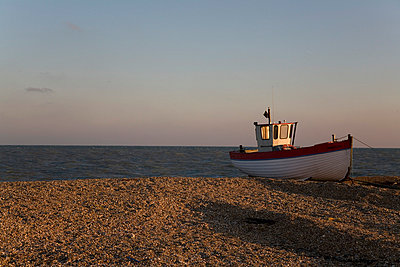 Fishing boat on beach - p3881146 by Ulrike Leyens