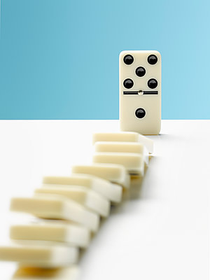 Domino toppling row of dominos - p1023m1506570 by Andy Roberts