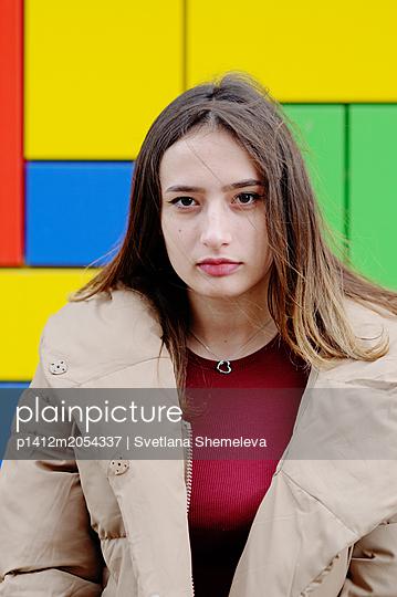 Portrait of a girl in a winter jacket - p1412m2054337 by Svetlana Shemeleva