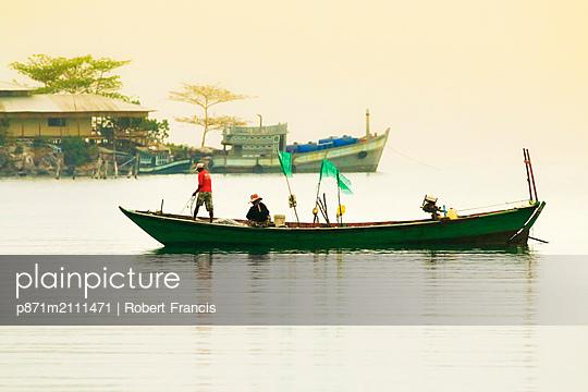 Fishing boat at dawn off the east coast of this holiday island, Saracen Bay, Koh Rong Sanloem Island, Sihanoukville, Cambodia, Indochina, Southeast Asia - p871m2111471 by Robert Francis