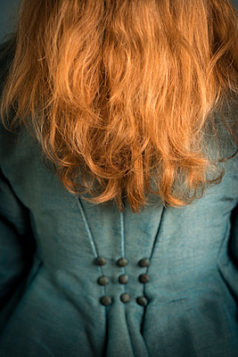 Back of female with long red hair in original Victorian dress. - p1433m1586196 by Wolf Kettler