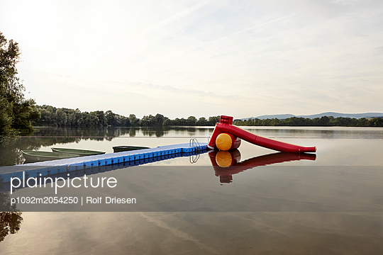 Open air pool with water slide on the lakefront - p1092m2054250 by Rolf Driesen