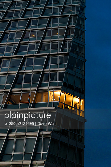 Illuminated office building in the evening - p1280m2124695 by Dave Wall