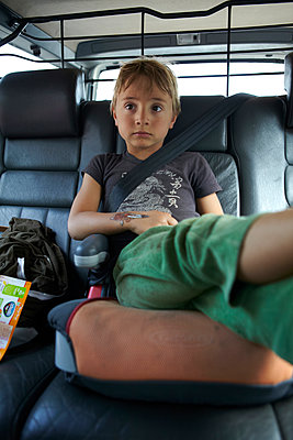 Boy in Car Seat - p1260m1073063 by Ted Catanzaro