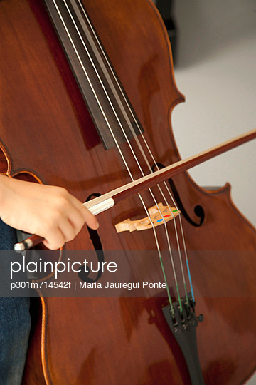Child playing cello - p301m714542f by Maria Jauregui Ponte