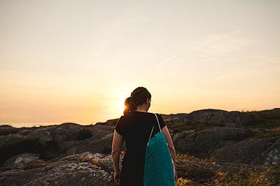 Woman at sunset - p312m2146285 by Stina Gränfors