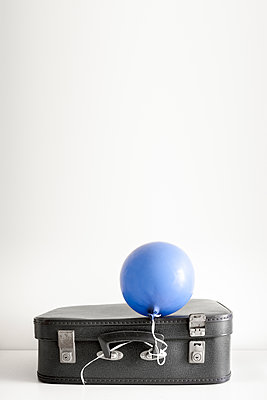 Old blue suitcase and balloon - p1228m1138255 by Benjamin Harte