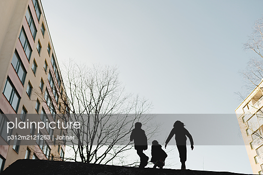 Silhouettes of children - p312m2121263 by Johner