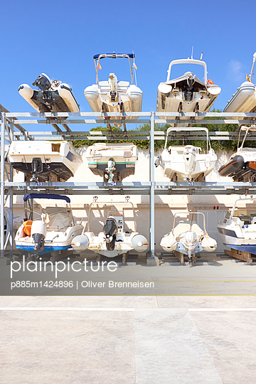 Motorboats stored on elevated hoists in Majorca - p885m1424896 by Oliver Brenneisen
