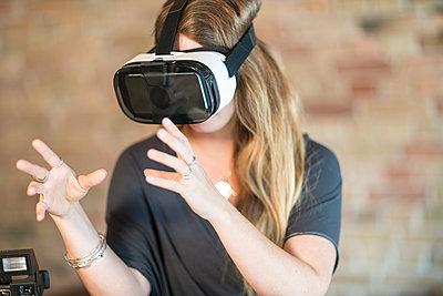 Woman using virtual glasses - p1332m1465127 by Tamboly
