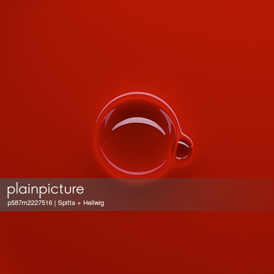 Bubbles on red - p587m2227516 by Spitta + Hellwig