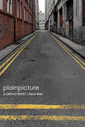 Empty street, yellow road markings - p1280m2182457 by Dave Wall