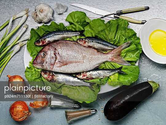 Raw fish and vegetables - p924m711130f by Stillfactory