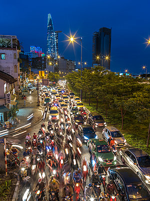 Rush-hour traffic in Saigon in the evening - p393m1452280 by Manuel Krug