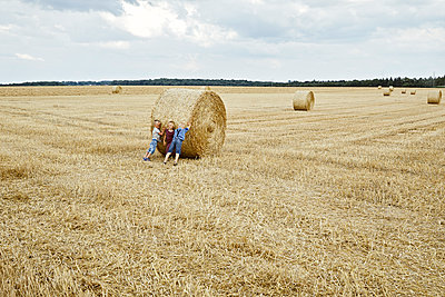 three children playing in a wheat field - p1540m2200516 by Marie Tercafs