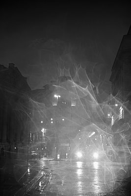 Bus on city street at night - p301m1406542 by Michael Mann
