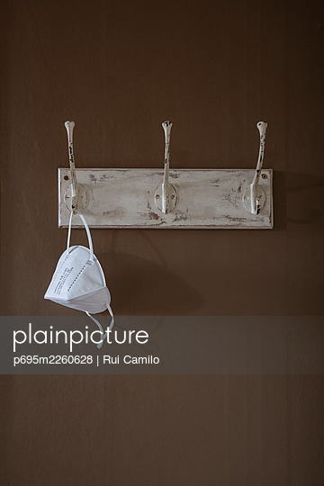 Masks on a coat hanger - p695m2260628 by Rui Camilo
