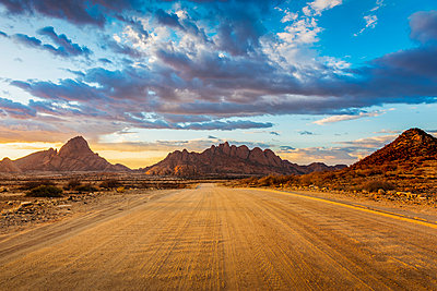 Spitzkoppe, Damaraland, Namibia, Africa. Gravel road to the granite peaks at sunset. - p651m2033381 by Marco Bottigelli