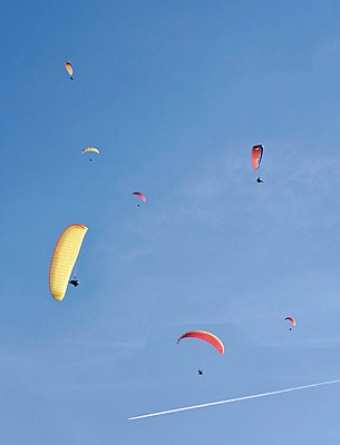 Paragliding in blue skies - p4295513 by Tino Tedaldi