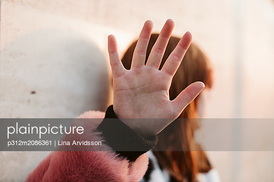 Close-up of female hand with fur sleeve - p312m2086361 by Lina Arvidsson