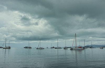 Boats under overcast sky - p1427m2067301 by Valeriya Tikhonova