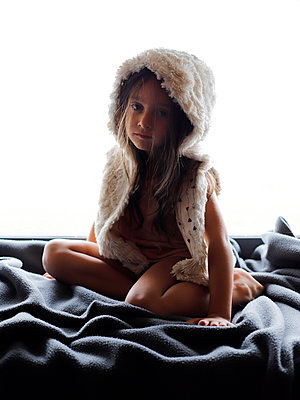 Little girl in a fur jacket - p1105m2211733 by Virginie Plauchut