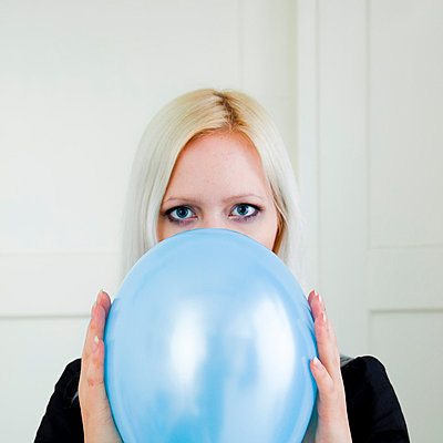 Woman with balloon - p4130695 by Tuomas Marttila