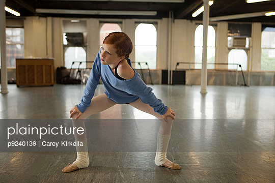 Ballet dancer warming up in dance studio
