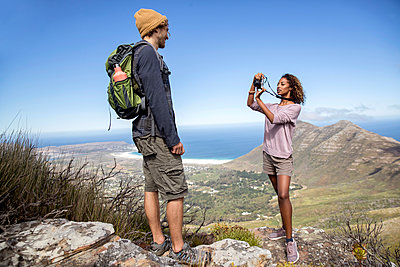 Young couple hiking in the mountains - p1355m1574183 by Tomasrodriguez