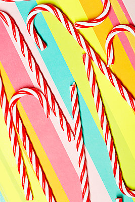 Candy canes on multi-coloured paper - p300m2024194 by Arman Zhenikeyev