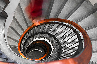 Person on spiral staircase - p31227592f by Hasse Bengtsson