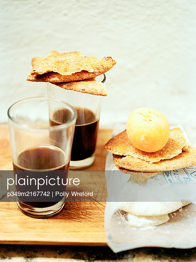 Espresso glasses and biscuits, Spain - p349m2167742 by Polly Wreford