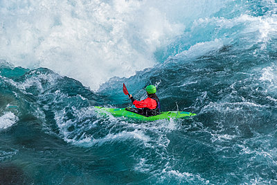 Kayaker descending the Futaleufu River, a class 5 river in Patagonia - p1166m2094129 by Cavan Images