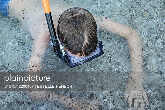 Snorkeling in shallow water - p1513m2200487 by ESTELLE FENECH