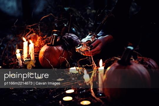 a halloween pumpkin head with smoke - p1166m2214673 by Cavan Images