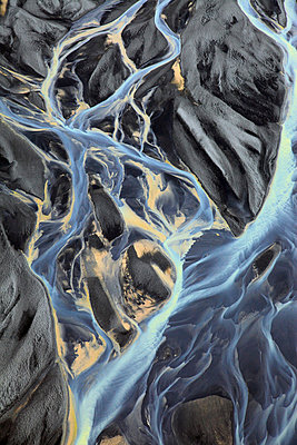 Aerail view of waterfall and meandering glacial river, Landmannalaugar, Iceland - p1026m992064f by Romulic-Stojcic
