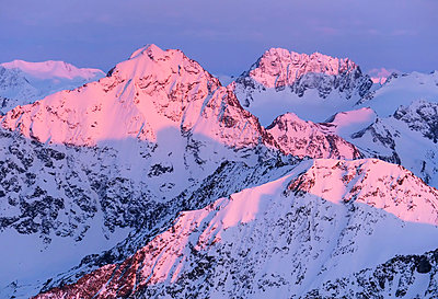 Alpenglow on eagle peak chugach mountains;Alaska united states of america - p442m837640f by Dan Bailey