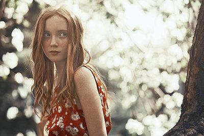 Beautiful tween girl in park - p1023m2088072 by Arman Zhenikeyev